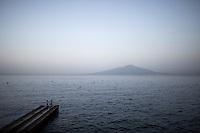 Mount Vesuvius is seen across the Gulf of Naples in the evening from Sorrento, Italy on Thursday, Sept. 17, 2015. (Photo by James Brosher)