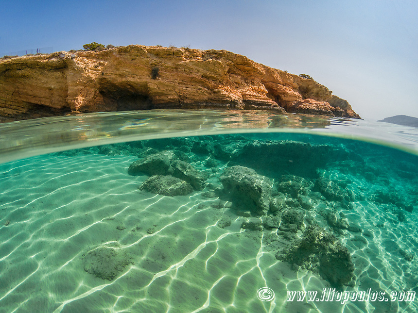 Half underwater view of an exotic beach of Koufonissi island, Greece