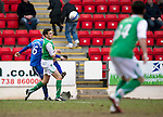 St Johnstone v Hibs....05.03.11 .Peter MacDonald crosses the ball which is deflected in by No 34 Richie Towell (right of pic).Picture by Graeme Hart..Copyright Perthshire Picture Agency.Tel: 01738 623350  Mobile: 07990 594431