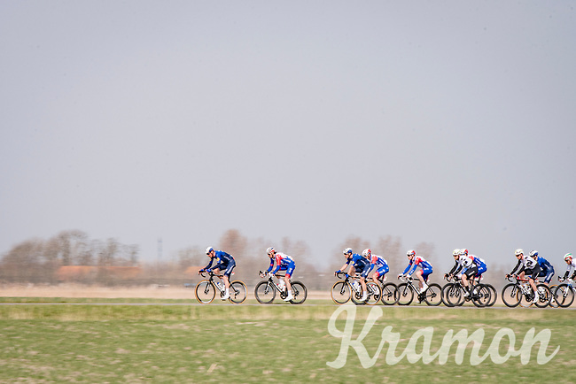 peloton led by Team Deceuninck - QuickStep & Team Groupama - FDJ<br /> <br /> 45th Oxyclean Classic Brugge-De Panne 2021 (ME/1.UWT)<br /> 1 day race from Bruges to De Panne (204km)<br /> <br /> ©kramon