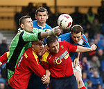 Albion keeper Neil Parry punches clear