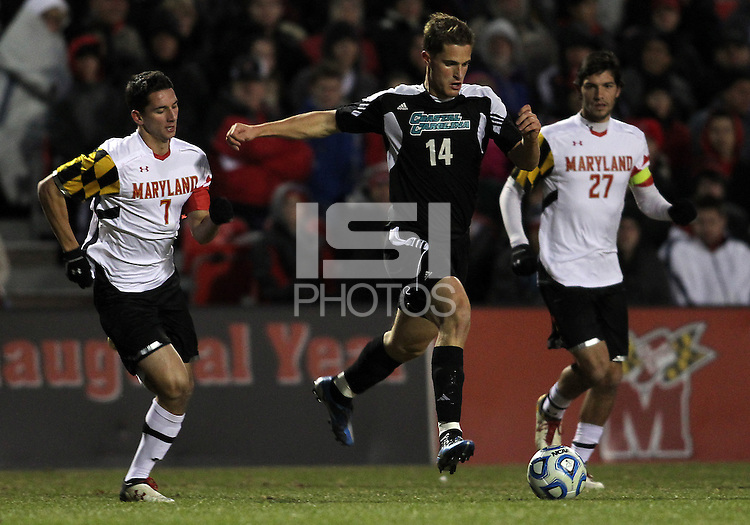 COLLEGE PARK, MD - NOVEMBER 25, 2012: Dan Metzger (7) of the University of Maryland chases after Jakub Stourac (14) of Coastal Carolina University during an NCAA championship third round match at Ludwig Field, in College Park, MD, on November 25. Maryland won 5-1.
