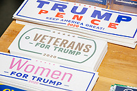 """Trump 2020 bumper stickers including ones reading """"Veterans for Trump"""" and """"Women for Trump"""" are seen on a desk in the office of the New Hampshire Republican State Committee in Concord, New Hampshire, on Wed., Sept. 16, 2020."""