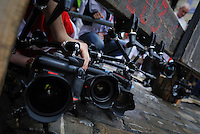 """A photographer placed cameras for  Miura bulls """"encierro"""" during the second San Fermin Festival bull run, on July 8, 2012, in Pamplona, northern Spain. The festival is a symbol of Spanish culture that attracts thousands of tourists to watch the bull runs despite heavy condemnation from animal rights groups . (c) Pedro ARMESTRE"""