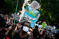 NEW YORK, NEW YORK - June 25: People march through Brooklyn Bridge as others take part in a protest encampment near NYC City hall on June 25, 2020 in New York, NY. Demonstrators are calling for $1 billion in cuts of NYPD, as they protest encampment near City Hall and NYPD headquarters ahead of the city July 1 budget deadline.  (Photo by Eduardo MunozAlvarez/VIEWpress)