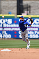Dunedin Blue Jays shortstop Jorge Flores (2) throws to first during a game against the Clearwater Threshers on April 6, 2014 at Bright House Field in Clearwater, Florida.  Dunedin defeated Clearwater 5-2.  (Mike Janes/Four Seam Images)
