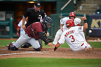 Frisco RoughRiders catcher Jorge Alfaro (8) can not come up with the throw as Nick Martini (3) slides safely into home as umpire Mike Cascioppo looks on during a game against the Springfield Cardinals on June 3, 2015 at Hammons Field in Springfield, Missouri.  Springfield defeated Frisco 7-2.  (Mike Janes/Four Seam Images)