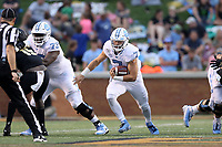 WINSTON-SALEM, NC - SEPTEMBER 13: Sam Howell #7 of the University of North Carolina runs the ball during a game between University of North Carolina and Wake Forest University at BB