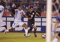 Mauricio Sabillon (16) battles against Jonathan Bornstein (12). US Men's National Team vs Honduras at Estadio Olimpico in San Pedro Sula, Honduras.