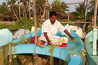 Fisherman repairing his nets at Beruwala, Sri Lanka