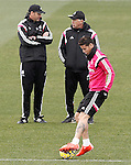 Real Madrid's coach Carlo Ancelotti (c), his second Paul Clement (l) and James Rodriguez during training session.January 30,2015.(ALTERPHOTOS/Acero)
