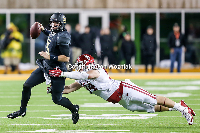 Baylor Bears quarterback Jarrett Stidham (3) and Oklahoma Sooners defensive end Matt Dimon (94) in action during the game between the Oklahoma Sooners  and the Baylor Bears at the McLane Stadium in Waco, Texas.