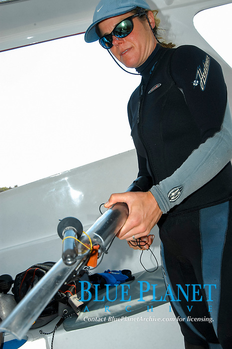 Marine Biologist Tierney Thys prepares a satellite tag to dive and tag a mola mola, or ocean sunfish, at Crystal Bay, Nusa Penida, Indonesia