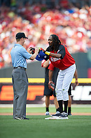 Rapper Snoop Dogg gets his sunglasses back from umpire Junior Valentine during the All-Star Legends and Celebrity Softball Game on July 12, 2015 at Great American Ball Park in Cincinnati, Ohio.  (Mike Janes/Four Seam Images)