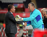 Brendan Rodgers of Swansea (L) greets Roger Freestone (R) during the Alan Tate Testimonial Match, Swansea City Legends v Manchester United Legends at the Liberty Stadium, Swansea, Wales, UK