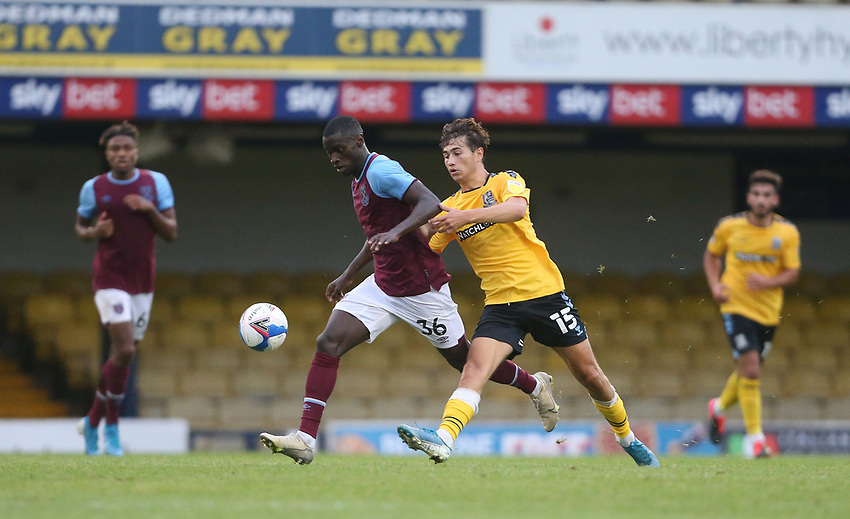 West Ham United's Mesaque Dju and Southend United's Lewis Gard<br /> <br /> Photographer Rob Newell/CameraSport<br /> <br /> EFL Trophy Southern Section Group A - Southend United v West Ham United U21 - Tuesday 8th September 2020 - Roots Hall - Southend-on-Sea<br />  <br /> World Copyright © 2020 CameraSport. All rights reserved. 43 Linden Ave. Countesthorpe. Leicester. England. LE8 5PG - Tel: +44 (0) 116 277 4147 - admin@camerasport.com - www.camerasport.com