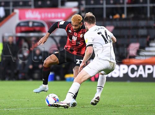 31st October 2020; Vitality Stadium, Bournemouth, Dorset, England; English Football League Championship Football, Bournemouth Athletic versus Derby County; Matthew Clarke of Derby County challenges Joshua King of Bournemouth for the ball