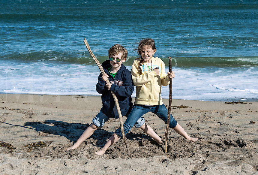 Brother and sister posing for a vacation photo, Cape Cod, Massachusetts, USA