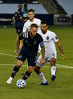 KANSAS CITY, KS - OCTOBER 07: #7 Johnny Russell of Sporting Kansas City shields the ball away from #3 Jonathan Bornstein of Chicago Fire FC during a game between Chicago Fire and Sporting Kansas City at Children's Mercy Park on October 07, 2020 in Kansas City, Kansas.