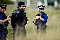 Pictured: Police officers at the scene as the search continues near Machynys, Llanelli, Wales, UK. Wednesday 04 November 2020  <br /> Re: Emergency services are searching for missing cockle picker Darren Rees, off the Carmarthenshire coast in Wales, UK.<br /> The 43 year old was last seen on Tuesday afternoon when he was cockling at low tide in the Machynys area of Llanelli.<br /> Dyfed-Powys Police, the coastguard and the national police helicopter are searching the coast and Loughor Estuary for Mr Rees.<br /> He was reported missing at about 18:40, but has not been seen since before it went dark.<br /> Police said he was last seen wearing green waders and a blue jumper, and have asked anyone who may have seen him to contact the force.