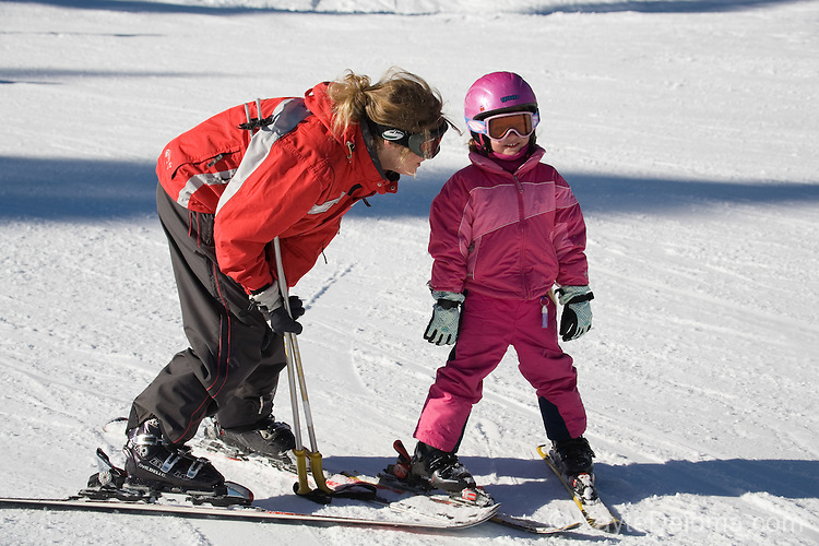 A young white girl gets a private skiing lesson at Northstar at Lake Tahoe, CA