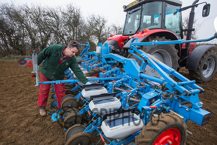 A farmer pouring sugar beet seed in to a drill<br /> Picture Tim Scrivener 07850 303986