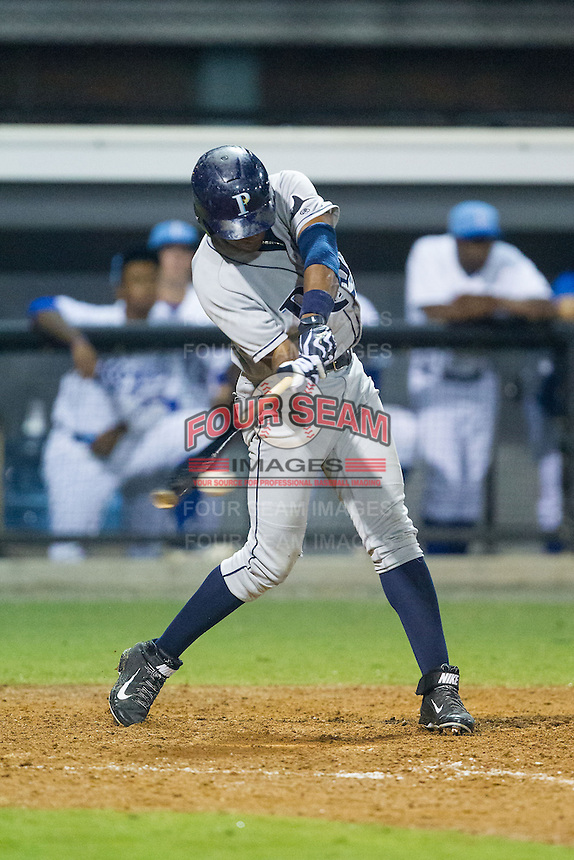 Manny Sanchez (13) of the Princeton Rays makes contact with the baseball during the game against the Burlington Royals at Burlington Athletic Park on July 9, 2014 in Burlington, North Carolina.  The Rays defeated the Royals 3-0.  (Brian Westerholt/Four Seam Images)