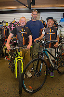 Joshua Johnson, age 13, left and Harlem Tamatea, age 12, receive their new bikes from Scott Guyton, centre, Kiwivelo bike presentation at Kiwivelo Cycling, Takapuna, New Zealand on Saturday, 7 November 2015. Photo: David Rowland / lintottphoto.co.nz