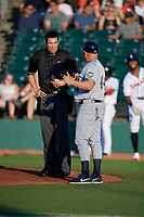 Burlington Bees maager Jack Howell (44) argues a call with Umpire Jae-Young Kim during a Midwest League game against the Lansing Lugnuts on July 18, 2019 at Cooley Law School Stadium in Lansing, Michigan.  Lansing defeated Burlington 5-4.  (Mike Janes/Four Seam Images)