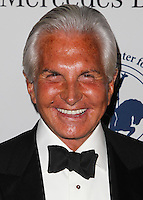 BEVERLY HILLS, CA, USA - OCTOBER 11: George Hamilton arrives at the 2014 Carousel Of Hope Ball held at the Beverly Hilton Hotel on October 11, 2014 in Beverly Hills, California, United States. (Photo by Celebrity Monitor)