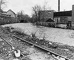 Railroad tracks along the Mad River disappear underwater as the river overflows its banks in 1979.