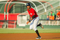 Juan Ramirez (28) of the Kannapolis Intimidators takes off for second base during the South Atlantic League game against the Greensboro Grasshoppers at CMC-Northeast Stadium on July 15, 2013 in Kannapolis, North Carolina.  The Intimidators defeated the Grasshoppers 4-0.   (Brian Westerholt/Four Seam Images)