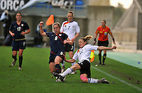 Amy Rodriguez faces a German tackle. The USA captured the 2010 Algarve Cup title by defeating Germany 3-2, at Estadio Algarve on March 3, 2010.