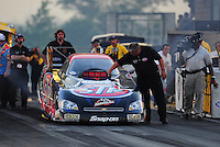 Jul, 8, 2011; Joliet, IL, USA: NHRA funny car crew members for driver Tony Pedregon during qualifying for the Route 66 Nationals at Route 66 Raceway. Mandatory Credit: Mark J. Rebilas-
