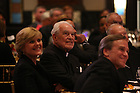 Notre Dame President Emeritus Rev. Theodore Hesburgh, center, NBC News correspondent Anne Thompson, left, and Notre Dame President John Jenkins listen as Fr. Hesburgh is honored on his 90th birthday at the Smithsonian Institution's National Portait Gallery in Washington D.C.  Photo by Matt Cashore