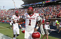 Arkansas quarterback Malik Hornsby (4) consoles quarterback KJ Jefferson (1), Saturday, October 9, 2021 at the end of a football game at Vaught Hemingway Stadium in Oxford, Miss. Check out nwaonline.com/211010Daily/ for today's photo gallery. <br /> (NWA Democrat-Gazette/Charlie Kaijo)