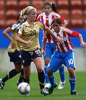 Olivia Klei (USA) and Ana Fleitas (PAR)..FIFA U17 Women's World Cup, Paraguay v USA, Waikato Stadium, Hamilton, New Zealand, Sunday 2 November 2008. Photo: Renee McKay/PHOTOSPORT