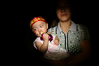 CHINA. Beijing. A mother and child near the Olympic village during the Beijing 2008 Summer Olympics. 2008