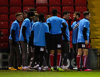 Lincoln City players during the pre-match warm-up, showing the logo the the Peter Crouch Podcast<br /> <br /> Photographer Andrew Vaughan/CameraSport<br /> <br /> The EFL Sky Bet League One - Lincoln City v Milton Keynes Dons - Tuesday 11th February 2020 - LNER Stadium - Lincoln<br /> <br /> World Copyright © 2020 CameraSport. All rights reserved. 43 Linden Ave. Countesthorpe. Leicester. England. LE8 5PG - Tel: +44 (0) 116 277 4147 - admin@camerasport.com - www.camerasport.com
