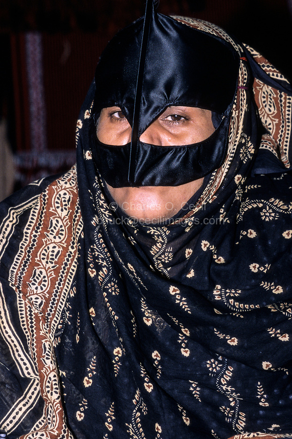 Qurum, Oman.  Middle-aged Woman Wearing a Face Mask (Burqa).