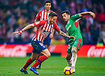 Saul Niguez Esclapez of Atletico de Madrid (L) competes for the ball with Jonathan Rodriguez Menendez, Jony, of Deportivo Alaves during the La Liga 2018-19 match between Atletico de Madrid and Deportivo Alaves at Wanda Metropolitano on December 08 2018 in Madrid, Spain. Photo by Diego Souto / Power Sport Images