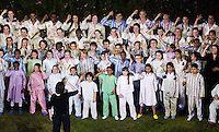 """27 JUL 2012 - LONDON, GBR - The Kaos Signing Choir for Deaf and Hearing Children perform during the """"Happy and Glorious"""" section of the Opening Ceremony of the London 2012 Olympic Games in the Olympic Stadium in the Olympic Park, Stratford, London, Great Britain (PHOTO (C) 2012 NIGEL FARROW)"""