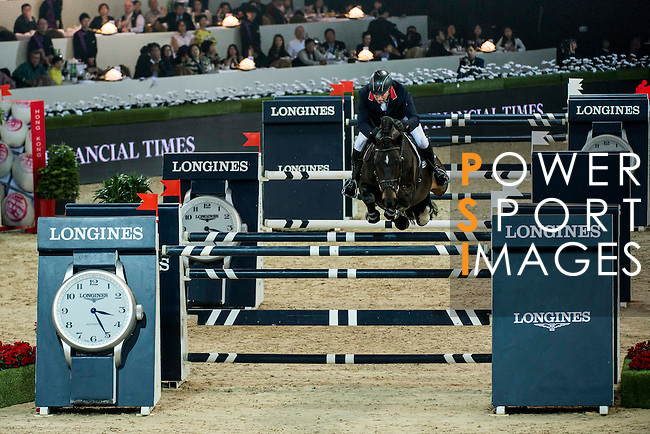 John Whitaker of United Kingdom rides Argento in action at the Longines Grand Prix during the Longines Hong Kong Masters 2015 at the AsiaWorld Expo on 15 February 2015 in Hong Kong, China. Photo by Aitor Alcalde / Power Sport Images