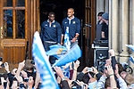 © Joel Goodman - 07973 332324  . 23/05/2011 . Manchester, UK . VINCENT KOMPANY (right) steps out from Manchester Town Hall ahead of the parade . Tens of thousands of fans line the streets of Manchester as Manchester City Football Club hold an open-topped bus parade through the city. The team are celebrating winning the FA Cup, their first trophy in 35 years, and for qualifying for next season's Champions League . Photo credit: Joel Goodman
