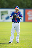 Witt Haggard (17) of the Kingsport Mets warms up in the outfield prior to the game against the Elizabethton Twins at Hunter Wright Stadium on July 8, 2015 in Kingsport, Tennessee.  The Mets defeated the Twins 8-2. (Brian Westerholt/Four Seam Images)