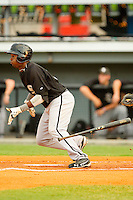 Courtney Hawkins #34 of the Bristol White Sox follows through on his swing against the Burlington Royals at Burlington Athletic Park on July 6, 2012 in Burlington, North Carolina.  The Royals defeated the White Sox 5-2.  (Brian Westerholt/Four Seam Images)