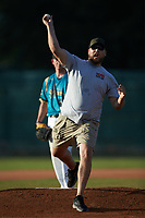A fan throws out a ceremonial first pitch prior to the Southern Collegiate Baseball League game between the Concord A's and the Mooresville Spinners at Moor Park on July 31, 2020 in Mooresville, NC. The Spinners defeated the Athletics 6-3 in a game called after 6 innings due to rain. (Brian Westerholt/Four Seam Images)