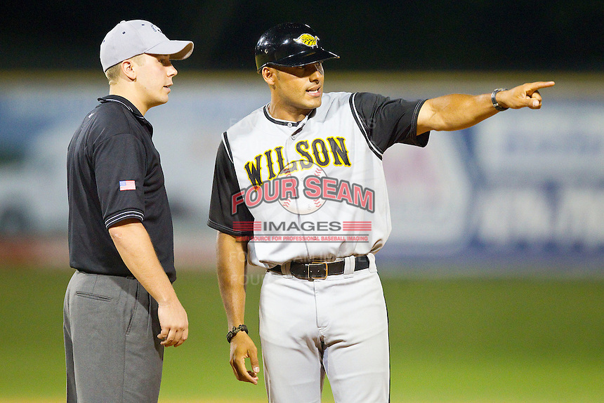 Wilson Tobs manager Austin Love (NC A&T) pleads his case with base umpire Matt Carlyon during the Coastal Plain League game against the High Point-Thomasville HiToms at Finch Field on June 17, 2013 in Thomasville, North Carolina.  The Tobs defeated the HiToms 3-2 in 11 innings.  Brian Westerholt/Four Seam Images