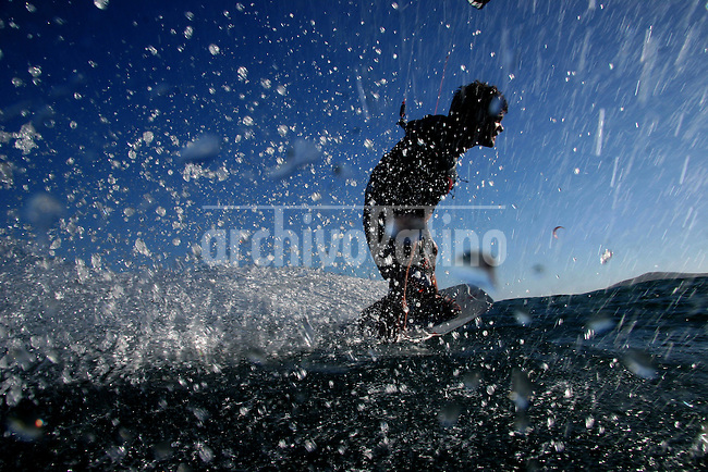 A kite-surfer is seen near the coast of Los Barriles, Baja California, Mexico  on December 20, 2005. .Born in Argentina, photographer Ivan Pisarenko in 2005  decided to ride his motorcycle across the American continent. While traveling Ivan is gathering an exceptional photographic document on the more diverse corners of the region. Archivolatino will publish several stories by this talented young photographer..Closer look at  Ivan's page www.americaendosruedas.com...