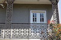 New Orleans, Louisiana.  Decorative Cast-iron Grillwork on a Garden District House.